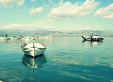 Small fishing boats in small marina Royalty Free Stock Photos