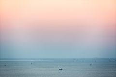 Small fishing boats in South China Sea at dusk, Mui Ne, Vietnam Royalty Free Stock Image