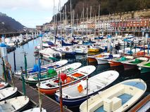 Small fishing boats and trawlers in the old port of San Sebastian royalty free stock images