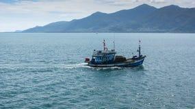 Small fishing craft in sea Stock Photo