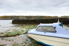 Small fishing dingy. Moored at low tide Royalty Free Stock Images