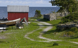 Small fishing huts.GN. Small fishing cottages next to the ocean during summer on the island Gotland in Sweden.GN stock photos