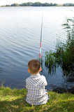 Small fishing man Royalty Free Stock Photography
