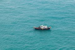 Small fishing motorboat boat goes slowly. In Busan area at sunny day, Japan Sea, South Korea stock image