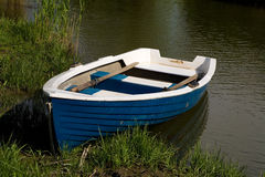Small fishing rowboat floating Royalty Free Stock Photography
