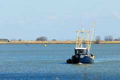 Small fishing ship Stock Images