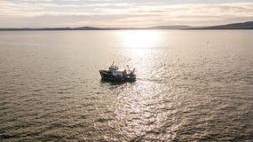 Trawler. A small fishing trawler off the coast of Ayrshire, Scotland Stock Photography