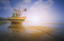 Small fishing vessels on the beach at dawn Stock Images