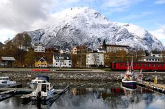 Small fishing village, fjord, Norway. Small fishing village at a base of a high mountain, Andalsnes, Norway Stock Photos