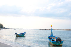Small fishing wooden boats in the sea Stock Photo