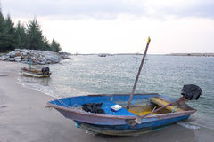 Small fishing wooden boats in the sea Royalty Free Stock Photo