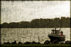 Small fishingboat closeup. And in a vintage style royalty free stock photo