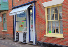 Small fishmongers shop with an awning. Royalty Free Stock Photography