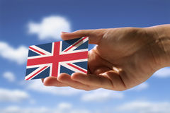 Small flag of Great Britain. Hand holding small flag of  Great Britain Stock Image