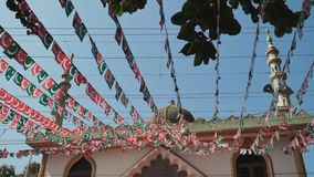 Small flags of the Indian Union Muslim League are hung over the streets of Goa. India. stock video footage