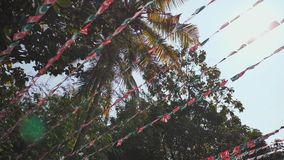 Small flags of the Indian Union Muslim League are hung over the streets of Goa. India. stock video