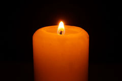 Small flame of burning candle Stock Image