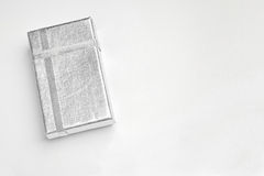 Small flat silver box with silver ribbons top Royalty Free Stock Photo