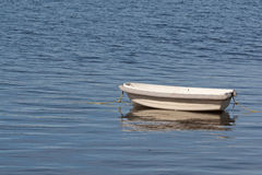 Small floating dinghy Royalty Free Stock Image