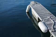Small floating pier for yachts mooring Stock Photos
