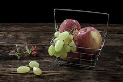 Small flower and apples and grapes. Stock Photography