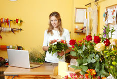 Small flower shop owner Royalty Free Stock Photo