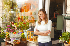Small flower shop owner Stock Image
