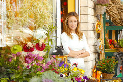 Small flower shop owner Stock Photography