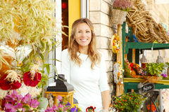 Small flower shop owner Royalty Free Stock Photos