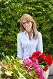 Small flower shop owner Stock Photo