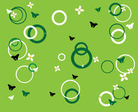 Small flowers and circles. Green background with flowers, circle shapes, and butterflies Stock Image