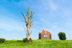 Small foghorn house in harbour of former island Schokland, Nethe Stock Images