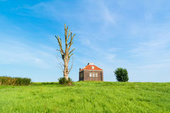 Small foghorn house in harbour of former island Schokland, Nethe Royalty Free Stock Images