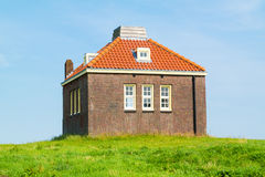 Small foghorn house in old harbour of former island Schokland, N Royalty Free Stock Images