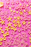 Small fondant decorations. Mini fondant decorations drying on a mattress royalty free stock photo