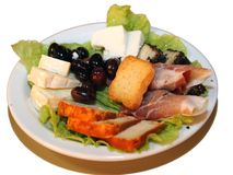 Small food plate. With han, cheese, toast and olives Stock Photos