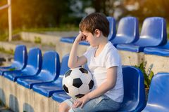 Small football fans disappointed. After the loss goal by his favorite team Royalty Free Stock Image
