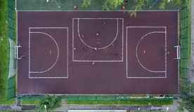 Small football field with asphalt in the Park view from drone