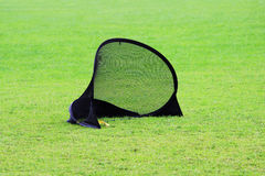 Small football gate for training kids to sports football in a stadium with green lawn grass Stock Photography