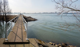 Small footbridge across the water Stock Photo