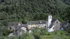 Small forgotten traditional village and church stock video footage
