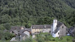 Small forgotten traditional village and church stock footage