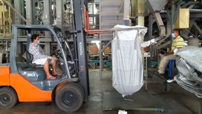 Small forklift lifts rice bags stock video footage