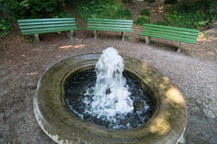 Small fountain and benches Stock Photography