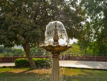 Small fountain at the city park royalty free stock image