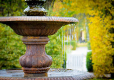 Small fountain in fall mood Royalty Free Stock Photography