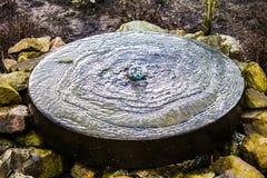 A small fountain in the garden Stock Photos