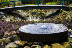 A small fountain in the garden Royalty Free Stock Image