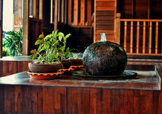Small fountain. In wooden house Stock Photography