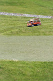 Small four-wheel drive truck at hay harvesting Stock Photography